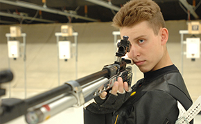 Rifle Claims Star; Downs Navy, 5820-5799