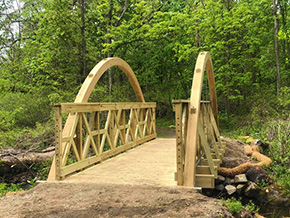 Colonel and Daughter Finish Trail Bridge Cadets Designed