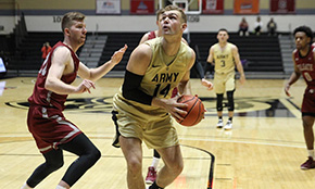 Men's Basketball Bests Holy Cross for First League Win