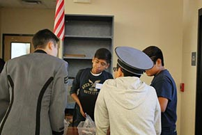Cadet Park works with students from Mulberry and Greco Middle Schools to build and program robots