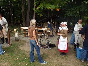 CDTs Mostert and Wentz (in period garb) discuss with the public how the Continental Army was fed and supplied