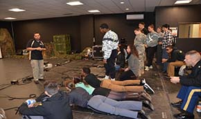 Cadets coach Vassar College guests prior to a scenario on the Engagement Skills Trainer