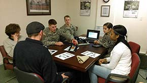 CDTs explain their initial prototype to supervisors and vocational specialists at Occupations Inc