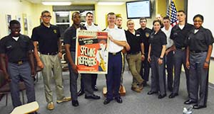 Members of the Jazz Forum present SFC Reifenberg with a poster as thanks for his presentation on jazz