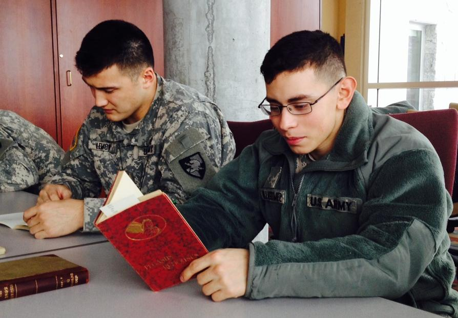"CDT Benjamin Lemon (C2, '17) and CDT Johnny Villagomez (H1, '17) enjoy perusing 1929 and 1936 editions of Pegasus Remounts, a collection of poetry and verse ""to suit every mood."""