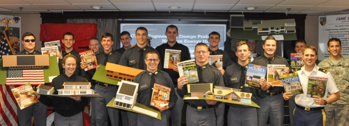 Cadets proudly display their model homes and some   of the issues of Fine Homebuilding Magazine that   inspired their designs.
