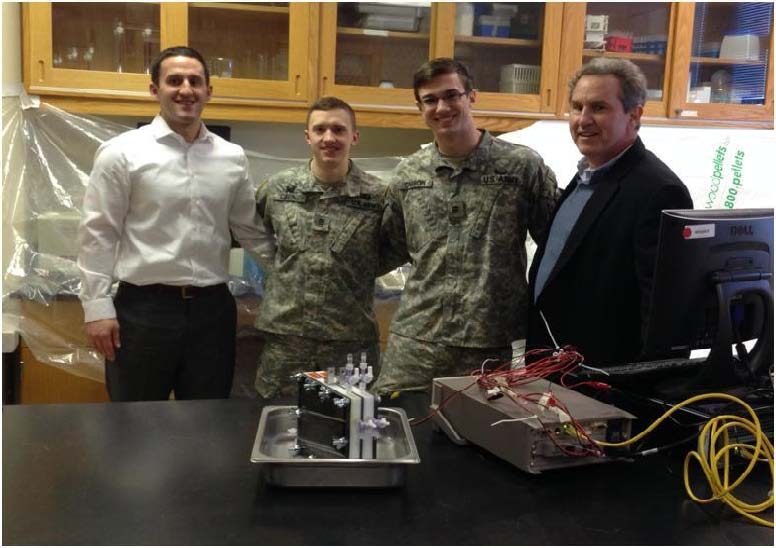 Picture: (L to R) Mr Anton Rozich, Cadet Lawrence Cavins (Company H-1), Cadet Christian   Carron (Company F-1) and Dr. Alan Rozich meet to discuss the application of microbial fuel   cells to treat wastewater.