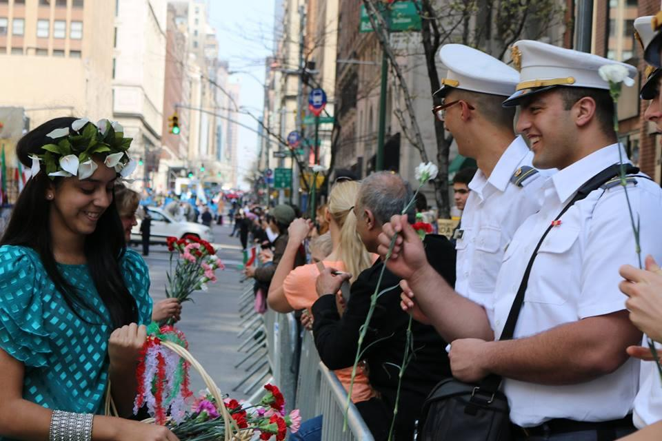 USMA Cadets are handed flowers by one of the participants in the 11th annual Persian Parade in New York City.