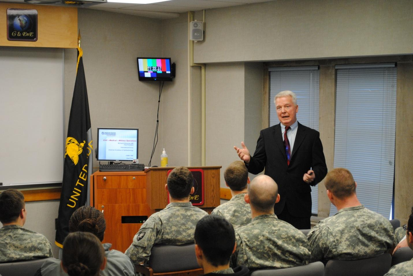 Dr. Michael Brennan '66 speaks to cadets in EV376.