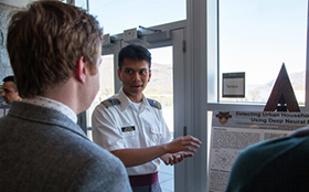 Cadet Don Dalisay of the Philippines interacts with visitors, showing them his research poster during the fourth Africa Symposium