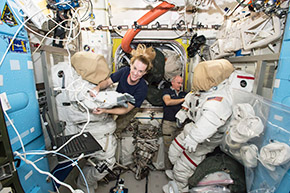 Expedition 48 crew members Kate Rubins and Jeff Williams '80 of NASA outfit spacesuits
