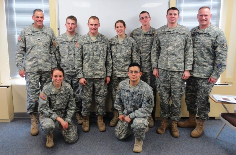 EN101 Course Director LTC Peter Molin and Department Head COL Scott Krawczyk with seven of the ten Best Essay authors. Standing from left to right: CDTs Brett Benedict, Andrew Beckman, Catherine Browning, Gregory Merkel, and Matthew Coughlan. Kneeling: CDTs Rachel Wolfe and Raoul Valencia. Not pictured: CDTs Ian Bedo, Gabriel Beck, and Edric Zahn.